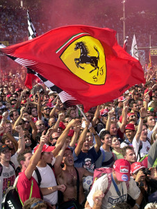 Ferrari's supporters celebrate after Michael Schumacher of Germany won the 71st Italy Grand Prix at Monza, Sunday, September 10, 2000. Finland's Mika Hakkinen of the McLaren Mercedes team placed second. (AP Photo/Domenico Stinellis)
