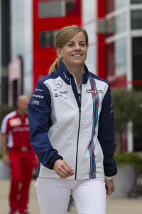 Williams test driver Susie Wolff walks through the paddock area before the British Formula One Grand Prix meeting at Silverstone circuit, Silverstone, England, Thursday, July 2, 2015. The British Formula One Grand Prix will be held on Sunday July 5. (AP Photo/Jon Super)