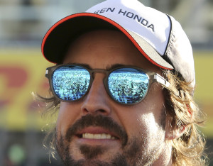 Spectators are reflected on sunglasses of McLaren driver Fernando Alonso of Spain upon his arrival for a fan meeting at the Suzuka Circuit in Suzuka, central Japan, Thursday, Oct. 6, 2016, ahead of Sunday's Japanese Formula One Grand Prix. (AP Photo/Toru Takahashi)