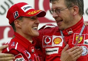 Ferrari driver Michael Schumacher, left, of Germany is congratulated by Ferrari team technical director Ross Brawn during the award ceremony of Japanese F-1 Grand Prix at the Suzuka circuit in Suzuka, central Japan, Sunday, Oct. 10, 2004. (AP Photo/Shizuo Kambayashi) COPYRIGHT SCANPIX SWEDEN Code: 436