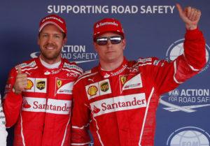 Formula One - F1 - Russian Grand Prix - Sochi, Russia - 29/04/17 - Ferrari Formula One drivers Sebastian Vettel of Germany and Kimi Raikkonen of Finland wave after qualifying session. REUTERS/Maxim Shemetov