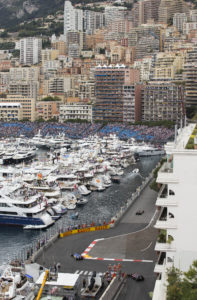 F1 racing cars take the harbor chicane during the Qualifying session at the Monaco racetrack, in Monaco, Saturday, May 23, 2015. The Formula One Grand Prix of Monaco will be held on Sunday. (AP Photo/Gero Breloer)