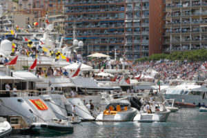 Spectators watch the Formula One Grand Prix from the stands, from balconies and from speedboats at the Monaco racetrack, in Monaco, Sunday, May 24, 2015. (AP Photo/Claude Paris)