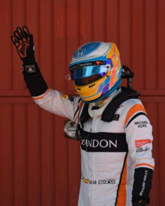 McLaren's Spanish driver Fernando Alonso waves in the parc ferme after the qualifying session at the Circuit de Catalunya on May 13, 2013 in Montmelo on the outskirts of Barcelona ahead of the Spanish Formula One Grand Prix. / AFP PHOTO / LLUIS GENE