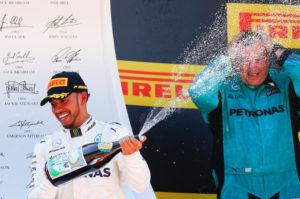 Formula One - F1 - Spanish Grand Prix - Barcelona-Catalunya racetrack, Montmelo Spain - 14/05/17 - Mercedes' Lewis Hamilton celebrates on the podium. REUTERS/Juan Medina