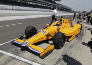 Fernando Alonso, of Spain, pulls out of the pits during a practice session for the Indianapolis 500 IndyCar auto race at Indianapolis Motor Speedway, Monday, May 15, 2017 in Indianapolis. (AP Photo/Darron Cummings)