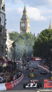 McLaren Honda's Stoffel Vandoorne, front, drives along Whitehall with Big Ben's clocktower in background, with large crowds watching during the F1 Live event along streets in central London, Wednesday, July 12, 2017.  F1 teams and cars have come to central London for a major fan event Wednesday. (Daniel Hambury/PA via AP)