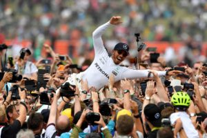 Winner Mercedes' British driver Lewis Hamilton is celebrated by fans after the British Formula One Grand Prix at the Silverstone motor racing circuit in Silverstone, central England on July 16, 2017. / AFP PHOTO / Ben STANSALL
