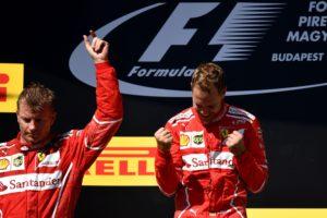 Winner Ferrari's German driver Sebastian Vettel (R) and second-placed Ferrari's Finnish driver Kimi Raikkonen celebrate on the podium after the Formula One Hungarian Grand Prix at the Hungaroring racing circuit in Budapest on July 30, 2017. / AFP PHOTO / ANDREJ ISAKOVIC