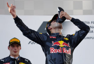 Red Bull driver Daniel Ricciardo of Australia drinks champagne from his shoe as he celebrates on the podium after winning the Malaysian Formula One Grand Prix at the Sepang International Circuit in Sepang, Malaysia, Sunday, Oct. 2, 2016. (AP Photo/Vincent Thian)