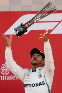 Mercedes' British driver and first place winner Lewis Hamilton celebrates on the podium after the Spanish Formula One Grand Prix at the Circuit de Catalunya in Montmelo in the outskirts of Barcelona on May 13, 2018. / AFP PHOTO / LLUIS GENE