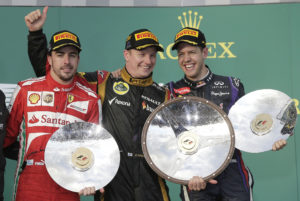 Lotus driver Kimi Raikkonen of Finland, center, celebrates with Ferrari's Fernando Alonso of Spain, left, and Red Bull's Sebastian Vettel of Germany after the Australian Formula One Grand Prix at Albert Park in Melbourne, Australia, Sunday, March 17, 2013. Raikkonen won ahead of Alonso second and Vettel third. (AP Photo/Rob Griffith)