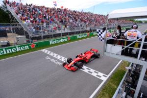 Formula One F1 - Canadian Grand Prix - Circuit Gilles Villeneuve, Montreal, Canada - June 10, 2018   Ferrari's Sebastian Vettel passes the chequered flag to win the race   Paul Chiasson/Pool via REUTERS