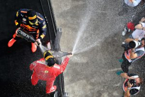 MONTREAL, QC - JUNE 10: Race winner Sebastian Vettel of Germany and Ferrari and third place finisher Max Verstappen of Netherlands and Red Bull Racing celebrate on the podium during the Canadian Formula One Grand Prix at Circuit Gilles Villeneuve on June 10, 2018 in Montreal, Canada.   Mark Thompson/Getty Images/AFP == FOR NEWSPAPERS, INTERNET, TELCOS & TELEVISION USE ONLY ==