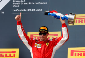Formula One F1 - French Grand Prix - Circuit Paul Ricard, Le Castellet, France - June 24, 2018 Ferrari's Kimi Raikkonen celebrates with the third placed trophy on the podium after the race REUTERS/Jean-Paul Pelissier