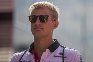 Swedish Formula One driver Marcus Ericsson of Sauber F1 Team arrives prior to the first free practice session for the Hungarian Formula One Grand Prix at the Hungaroring circuit, in Mogyorod, north-east of Budapest, Hungary, Friday, July 27, 2018. The Hungarian Formula One Grand Prix will take place on Sunday. (Zoltan Balogh/MTI via AP)