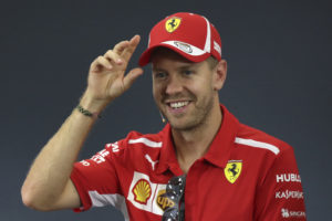 Ferrari driver Sebastian Vettel of Germany reacts as he attends a press conference at the Suzuka Circuit ahead of the Japanese Formula One Grand Prix in Suzuka, central Japan, Thursday, Oct. 4, 2018. (AP Photo/Ng Han Guan)
