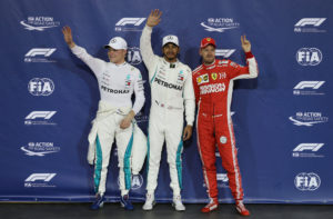 Formula One F1 - Abu Dhabi Grand Prix - Yas Marina Circuit, Abu Dhabi, United Arab Emirates - November 24, 2018  Mercedes' Lewis Hamilton celebrates pole position as second place Mercedes' Valtteri Bottas and third place Ferrari's Sebastian Vettel look on  REUTERS/Hamad I Mohammed
