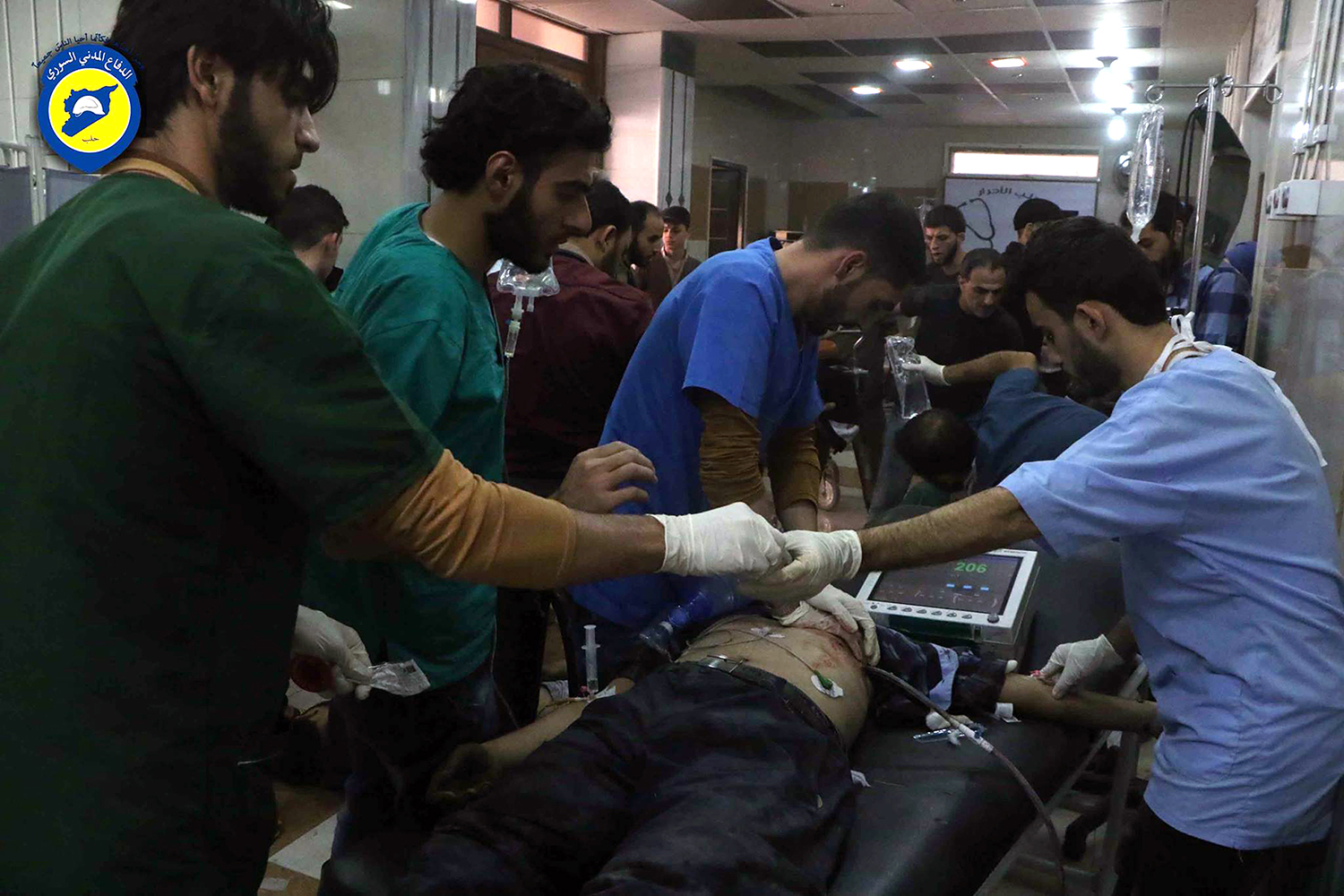 """In this photo provided by the Syrian Civil Defense group known as the White Helmets, shows wounded receiving treatment at a local clinic after airstrikes hit Aleppo, Syria, Sunday, Sept. 25, 2016. A broad coalition of Syrian rebels denounced international negotiations for peace as """"meaningless"""" on Sunday, as the U.N. Security Council prepared to convene an emergency meeting about the spiraling violence in Syria. (Syrian Civil Defense White Helmets via AP)"""