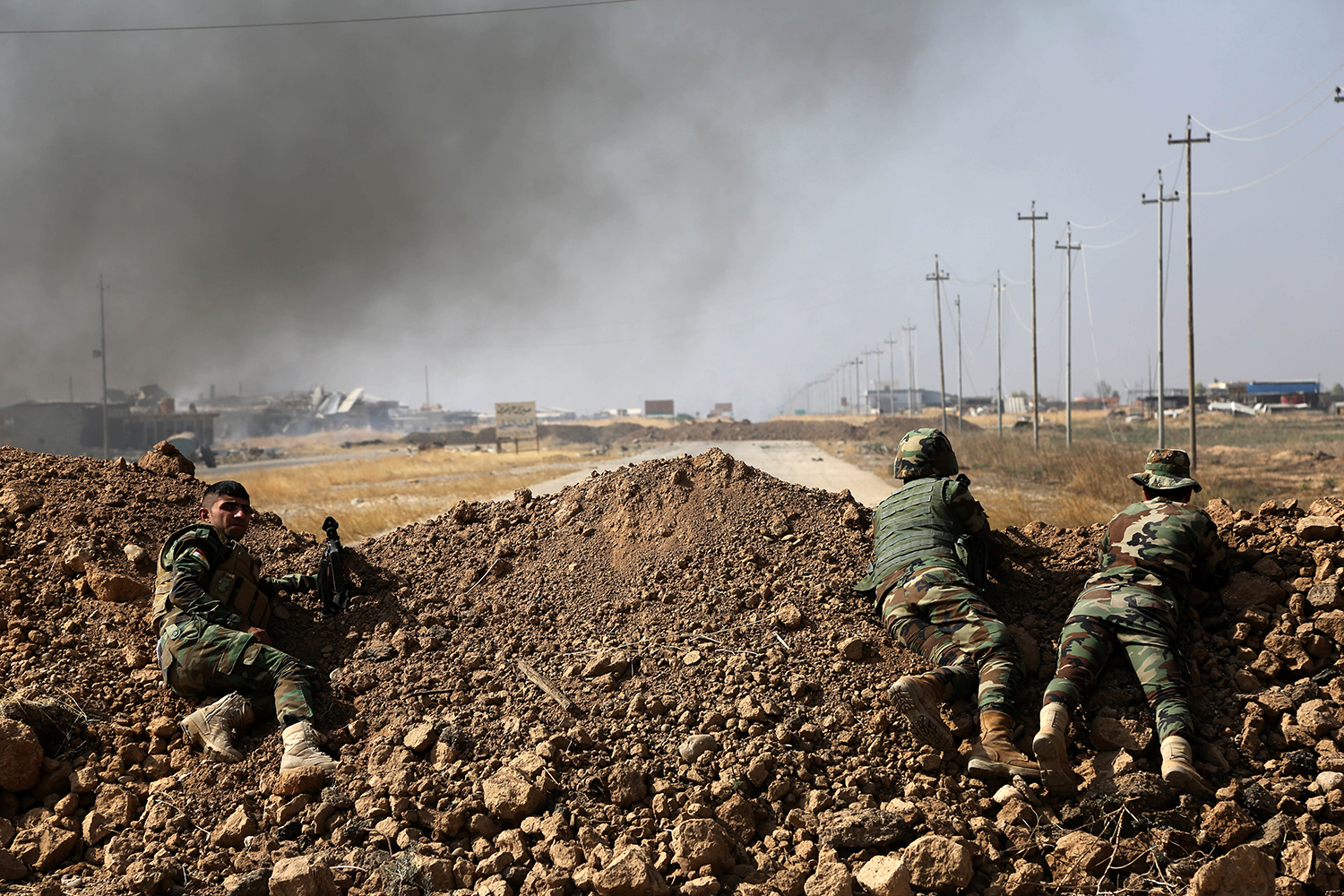 Kurdish security forces take up a position as they fight overlooking the Islamic State-controlled in villages surrounding Mosul, in Khazer, about 30 kilometers (19 miles) east of Mosul, Iraq, Monday, Oct. 17, 2016. Iraqi government and Kurdish forces, backed by U.S.-led coalition air and ground support, launched coordinated military operations early on Monday as the long-awaited fight to wrest the northern city of Mosul from Islamic State fighters got underway.(AP Photo)