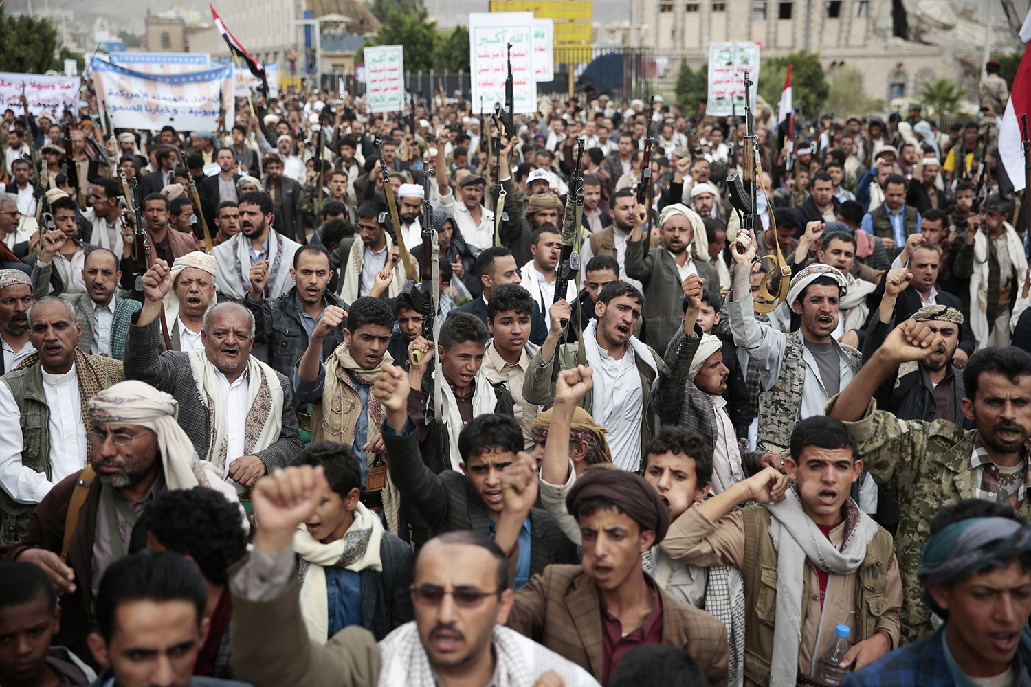 Shiite tribesmen, known as Houthis, hold their weapons as they chant slogans during a rally in support of the Houthi movement in Sanaa, Yemen, Monday, July 18, 2016. (AP Photo/Hani Mohammed)
