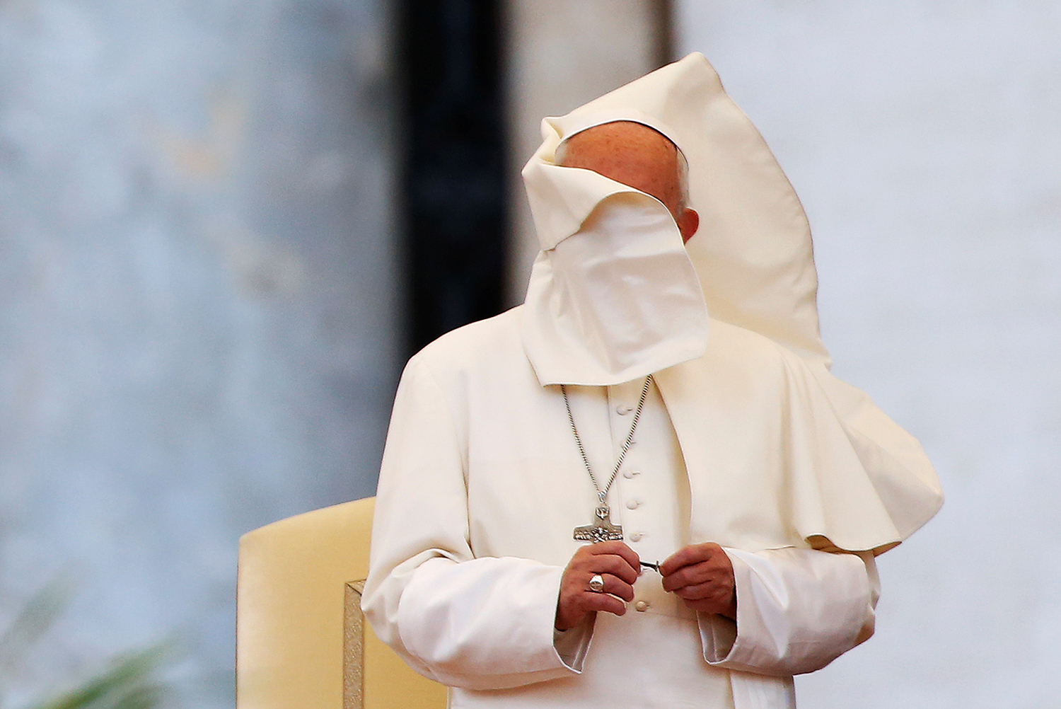 A gust of wind blows Pope Francis' mantle as he attends a Marian