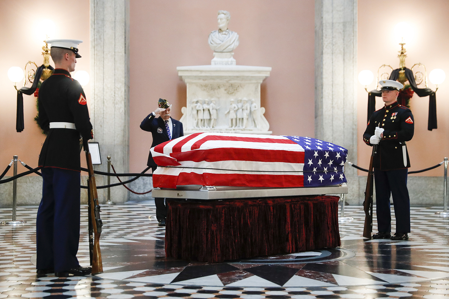 Marines stand guard at the casket of the John Glenn as he lies in repose, Friday, Dec. 16, 2016, in Columbus, Ohio. Glenn's home state and the nation began saying goodbye to the famed astronaut as he lies in state at Ohio's capitol building. Glenn, 95, the first American to orbit Earth, died last week. (AP Photo/John Minchillo)