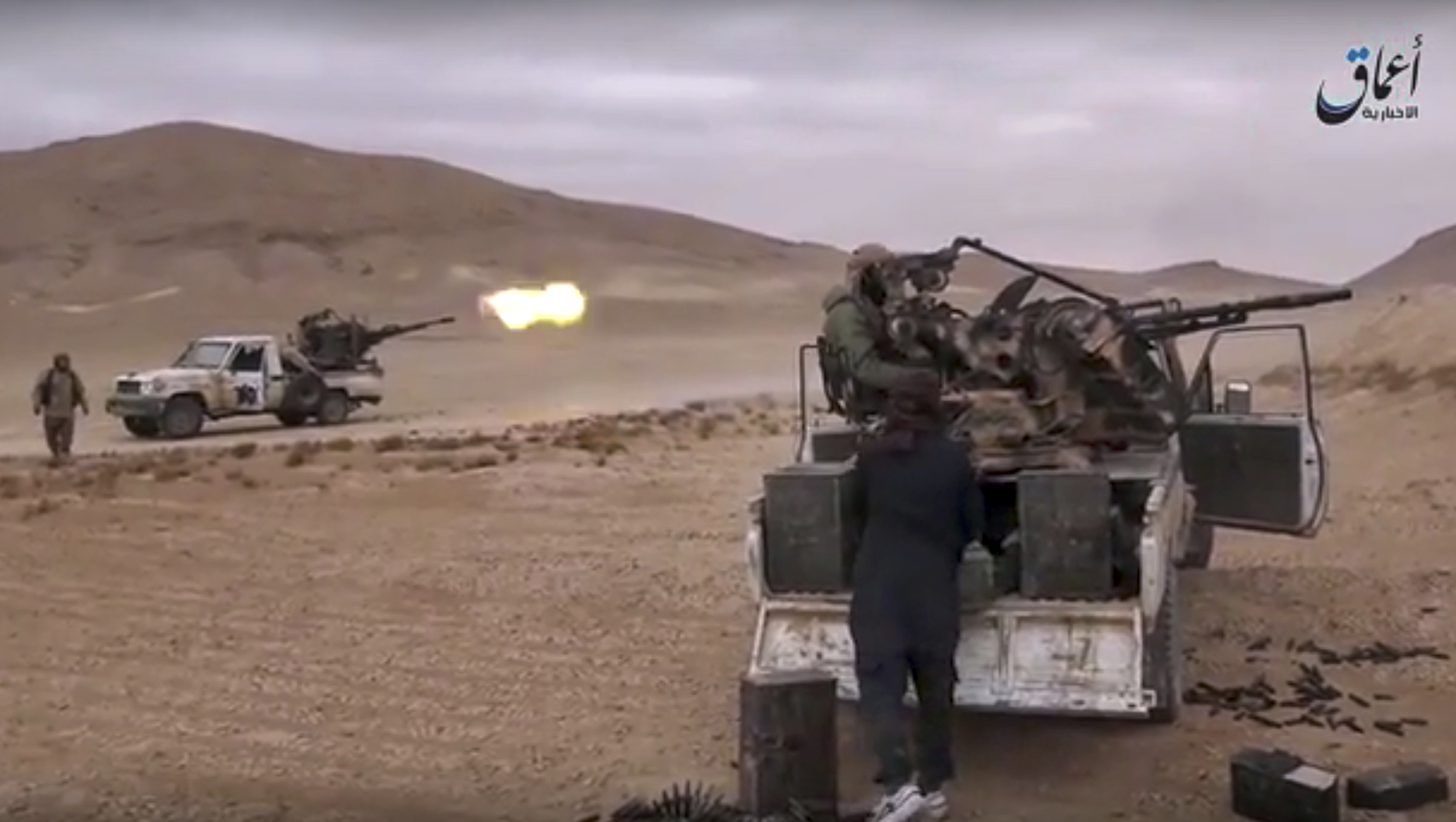 This image made from militant video posted online by the Aamaq News Agency, a media arm of the Islamic State group on Saturday, Dec. 10, 2016, purports to show gun-mounted vehicles operated by the group firing at Syrian troops in the Hayan mountain south of Palmyra, in Homs province, Syria. Syrian opposition activists say the Islamic State group has regained control of the ancient town of Palmyra despite a wave of Russian airstrikes in a major advance after a year of setbacks for the group in Syria and Iraq. (Militant Video via AP)