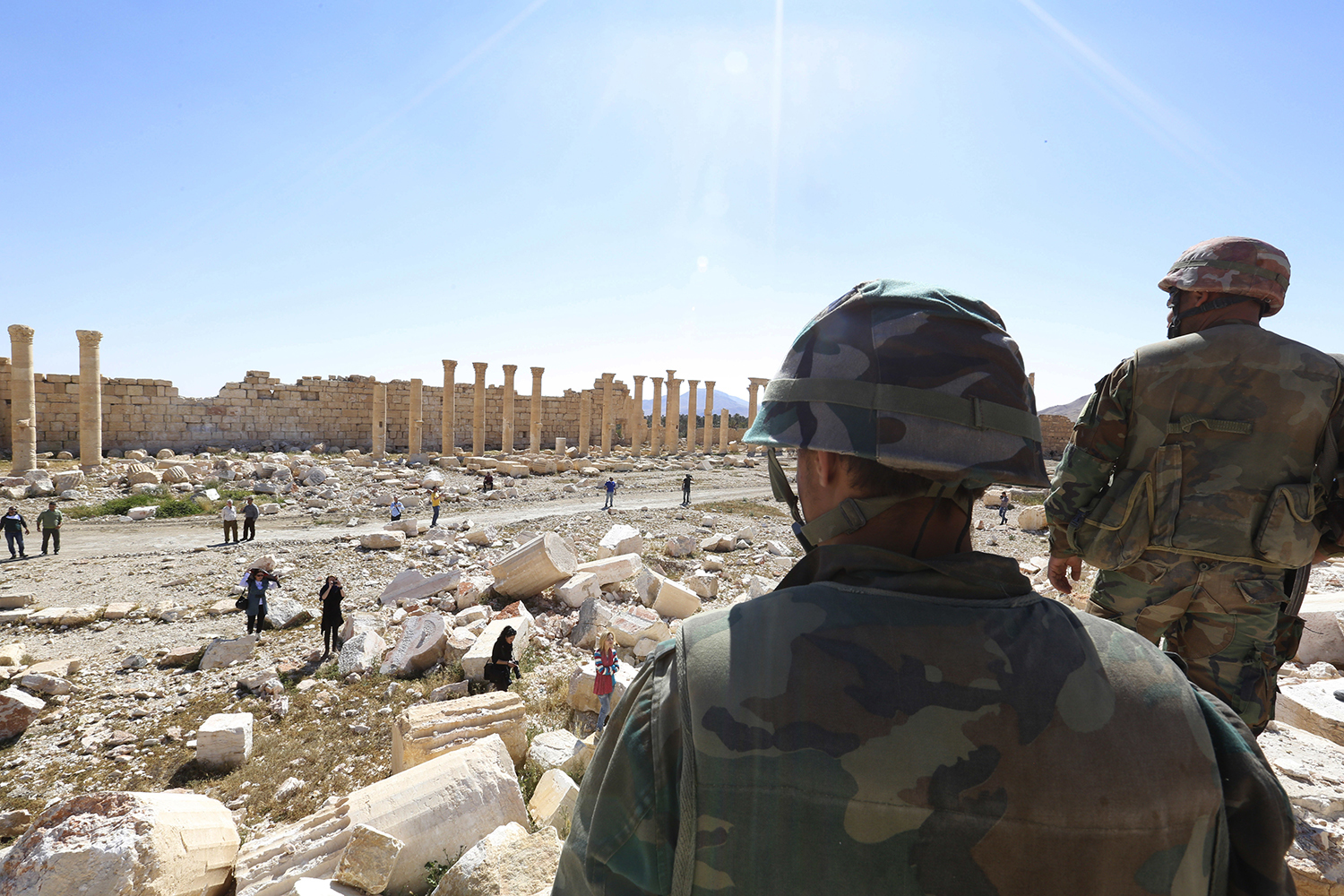 FILE -- In this April 1, 2016 file photo, soldiers look over damage at the historical Bel Temple in the ancient city of Palmyra, Homs provence, Syria. Palmyra, the archaeological gem that Islamic State fighters retook Sunday, Dec. 11, 2016, from Syrian troops, is a desert oasis surrounded by palm trees, and a UNESCO world heritage site, that boasts 2,000-year-old towering Roman-era colonnades and priceless artifacts. It is also a strategic crossroads linking the Syrian capital, Damascus, with the country's east and neighboring Iraq. (AP Photo, File)