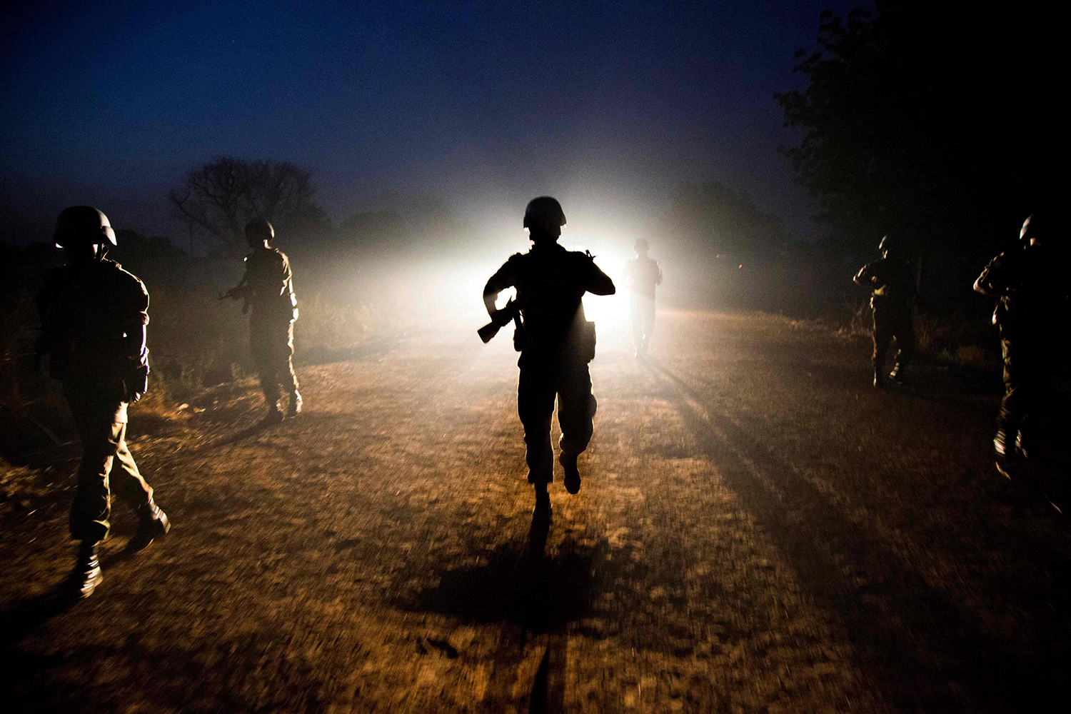 TOPSHOT - Peacekeeper troops from Ethiopia and deployed in the United Nations (UN) Interim Security Force for Abyei (UNISFA) patrol at night in Abyei town, Abyei state, on December 14, 2016. The Abyei Administrative Area is a disputed territory between Sudan and South Sudan with a longstanding intercommunal tensions between the Ngok-Dinka ethnic majority and the pastoral Misseriya population, who migrate through the area seasonally from the north. An attack by Government of Sudan forces on Abyei in May 2011 displaced the majority of the Ngok Dinka population, approximately 105,000 people to areas south of the River Kiir, which became overcrowded and are suffering a huge competition over natural resources. / AFP PHOTO / Albert Gonzalez Farran / TT / kod 444