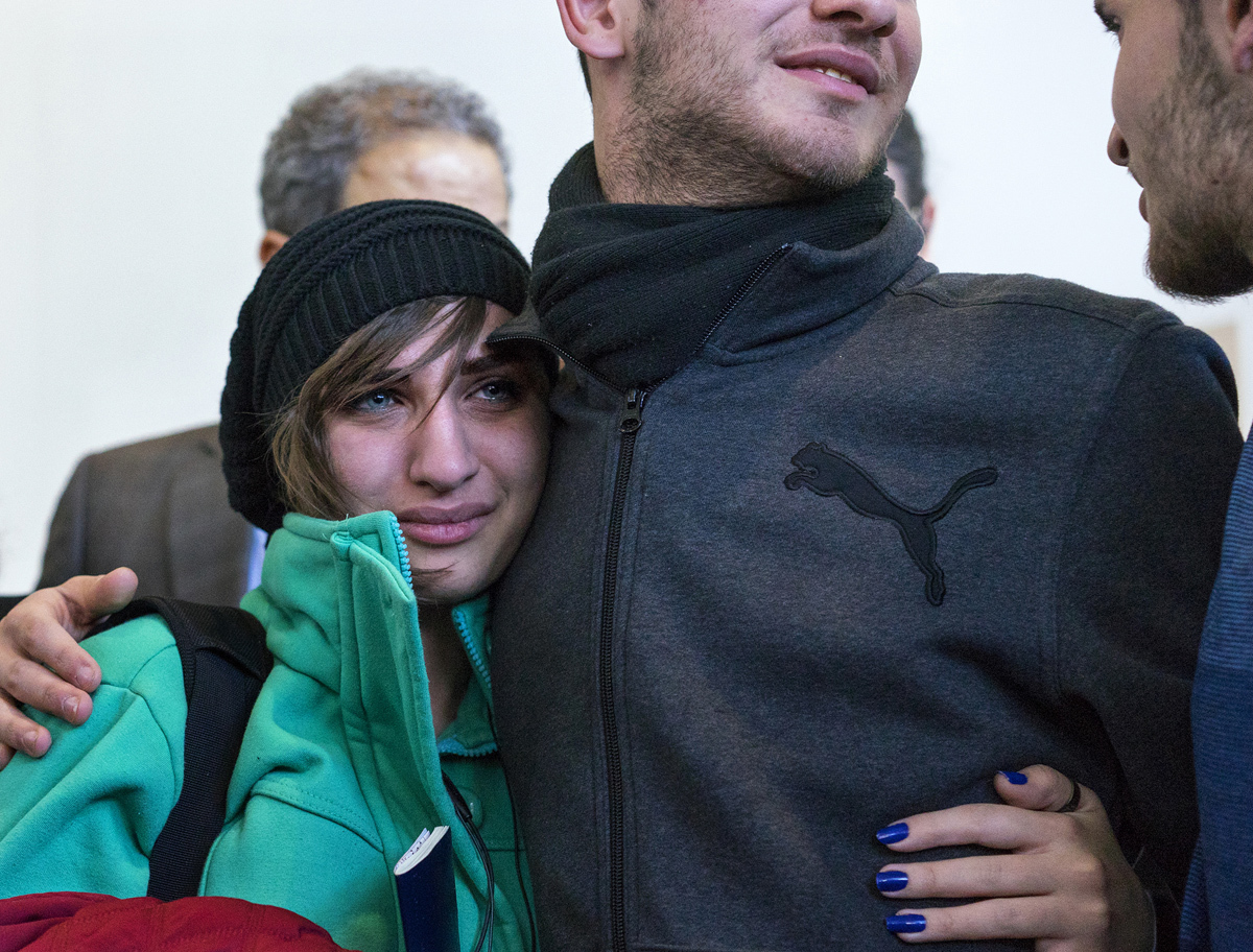 Sarah Assali, 19, left, who just arrived from Syria, is embraced by her brother Tawfik Assali, 21, of Allentown, Pennsylvania, upon her and other family members' arrival from Syria at Terminal at John F. Kennedy International Airport in New York on February 6, 2017. Attorneys said Dr. Assali's brothers, their wives and their two teenage children returned to Syria after they were denied entrance to the United States on January 28 although they had visas in hand after a 13-year effort. # Craig Ruttle / AP