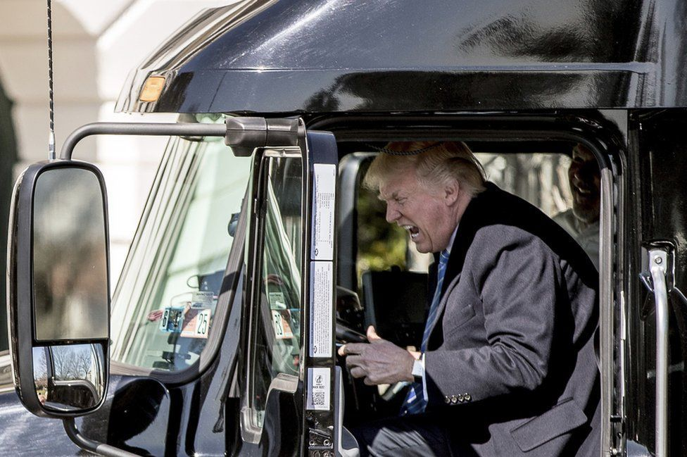 US President Donald Trump in the cab of an 18-wheel vehicle as he meets truckers on the south lawn of the White House. President Trump was discussing his healthcare proposals, which have been going through Congress. ANDREW HARNICK / AP