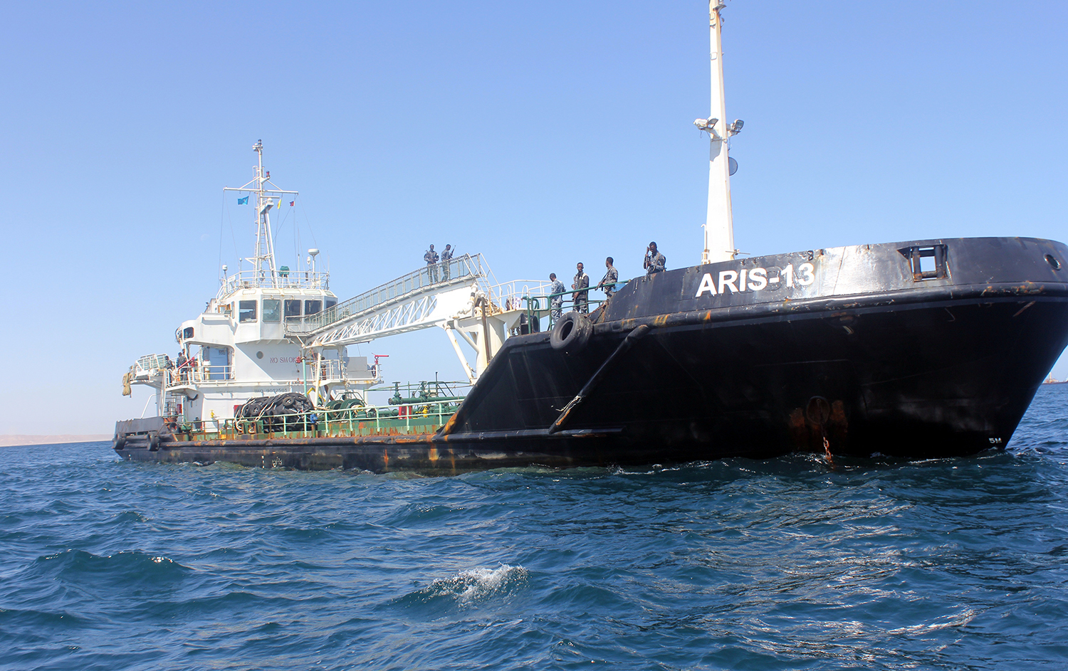 BOSASSO 2017-03-19 Maritime police are seen aboard oil tanker Aris-13, which was released by pirates, as it sails to dock on the shores of the Gulf of Aden in the city of Bosasso, northern Somalia's semi-autonomous region of Puntland, March 19, 2017. REUTERS/Abdiqani Hassan FOR EDITORIAL USE ONLY. NO RESALES. NO ARCHIVES. TPX IMAGES OF THE DAY Photo: / REUTERS / TT / kod 72000