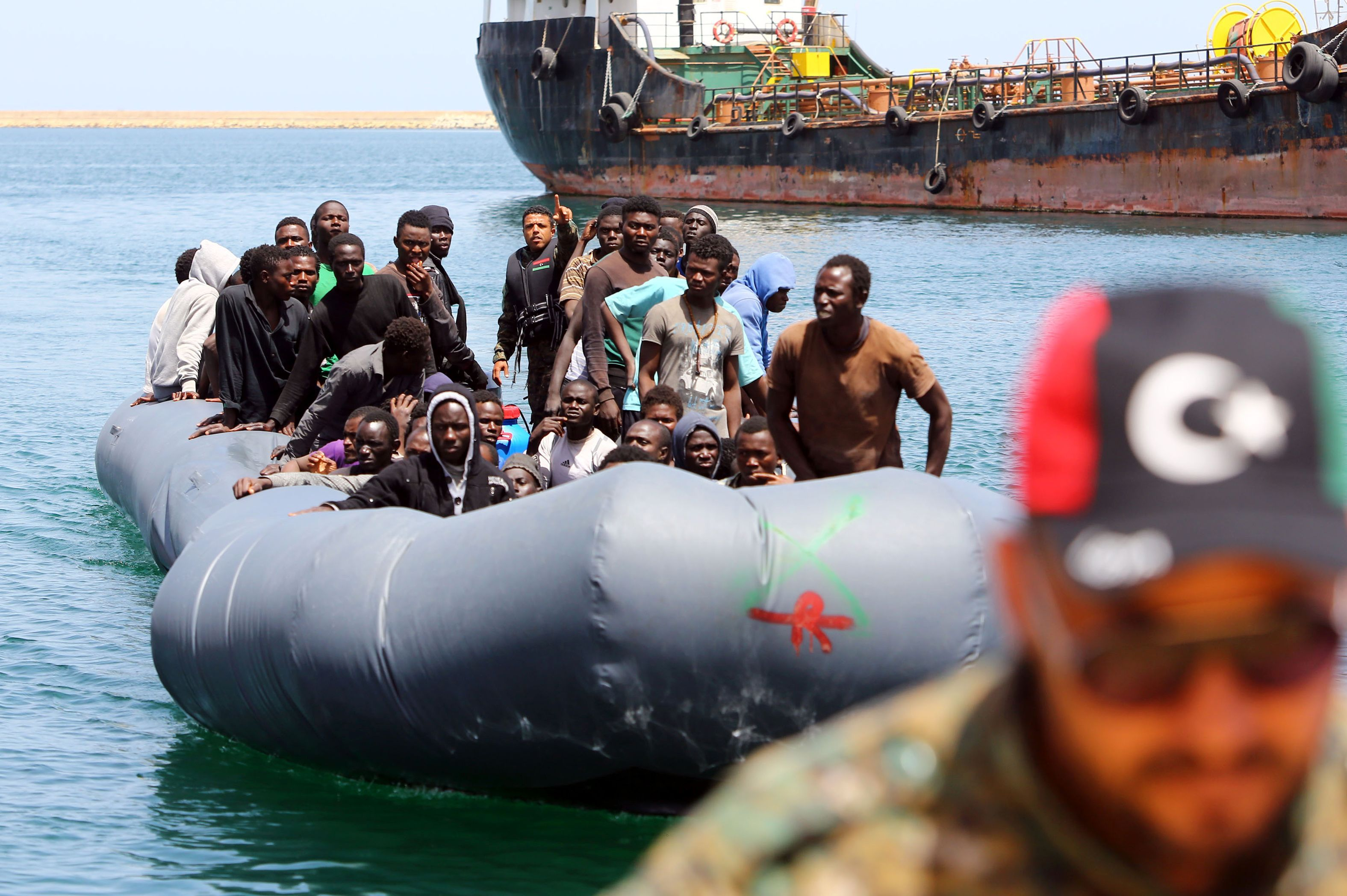 TOPSHOT - Illegal migrants, who were rescued by the Libyan coastguard in the Mediterranean Sea off the Libyan coast, arrive at the naval base in the capital Tripoli on May 6, 2017. / AFP PHOTO / MAHMUD TURKIA / TT / kod 444