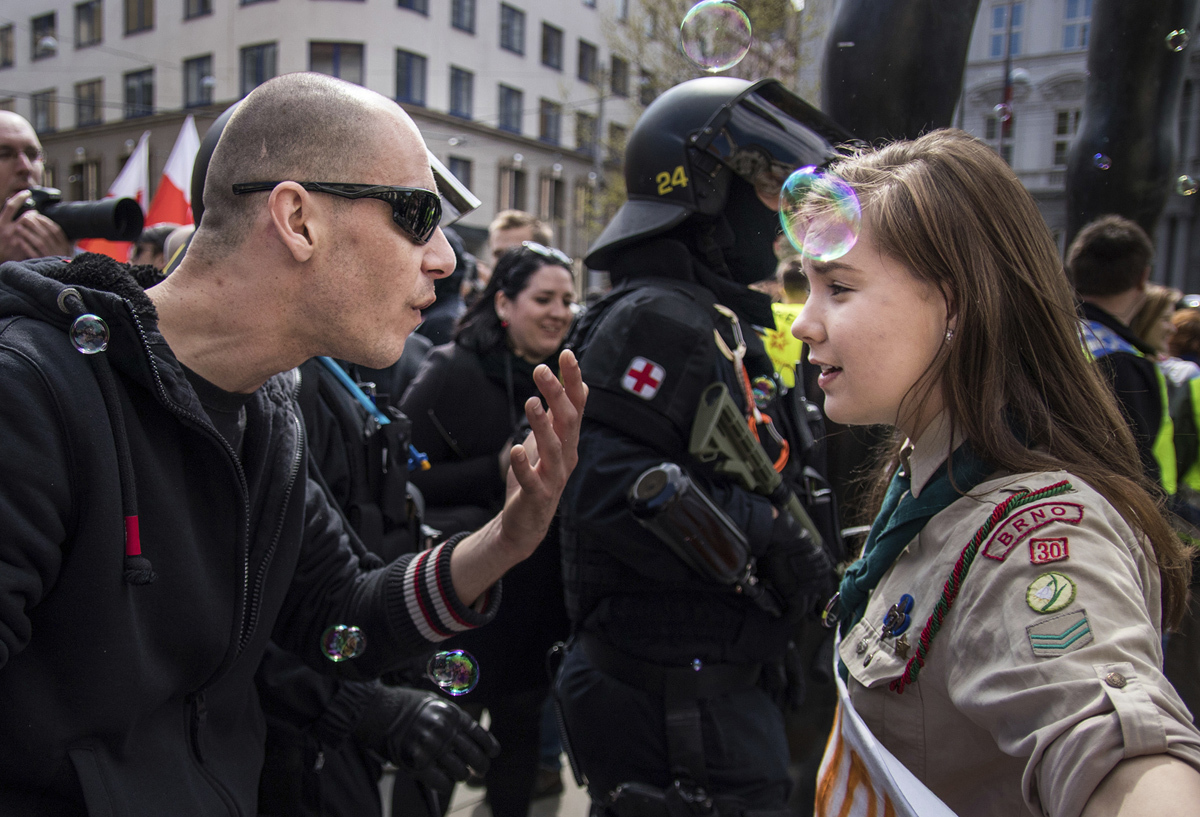 16-year-old Lucie Myslikova confronts a a protester at a right wing demonstration on May 1, 2017. The Czech teenager was among some 300 protesters who confronted a rally of the far right Workers Party of Social Justice on May Day in the second largest Czech city of Brno. # Vladimir Cicmanec / AP
