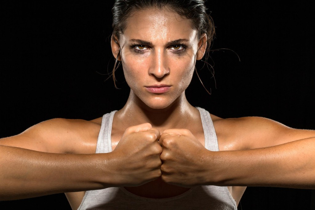 Strong strength confidence power determination relentless conviction female athlete trainer conceptual Boxer fighter MMA tough woman athlete exercise training posing portrait champion intimidating