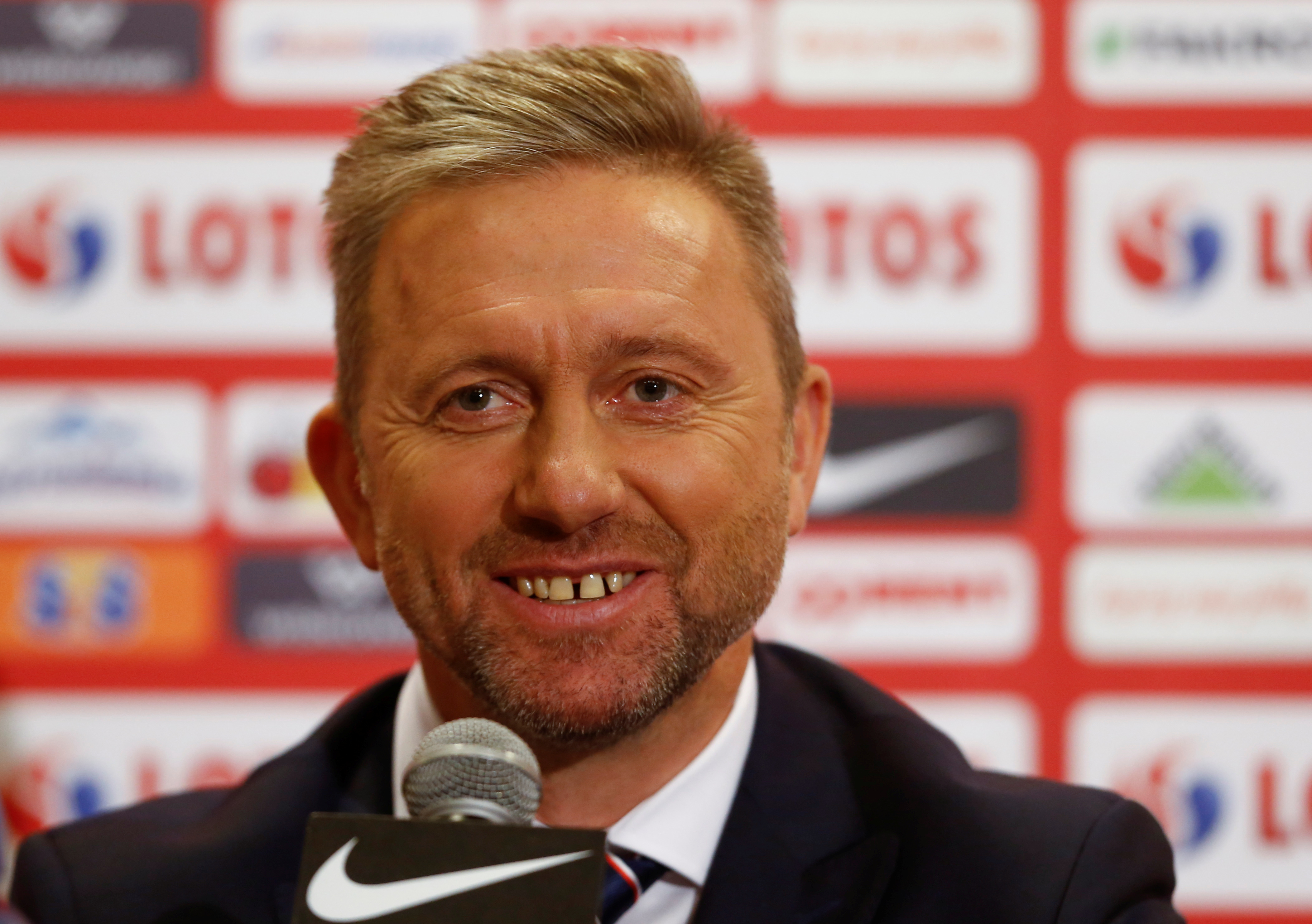 Jerzy Brzeczek, new coach for the Polish national soccer team smiles as he attends a news conference at National Stadium in Warsaw, Poland July 23, 2018. REUTERS/Kacper Pempel