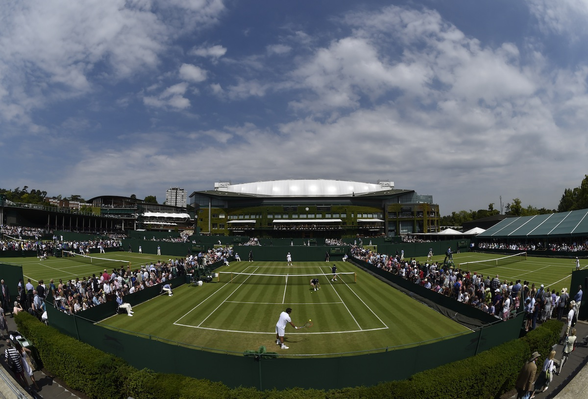 A ball-boy picks up the ball at the Wimbledon Tennis Championships, in London